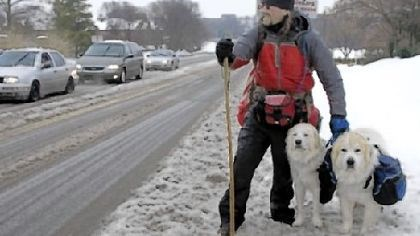 Snow walkers Luke Robinson of Austin, Texas, on a snow-covered road this winter as he walked from Austin toward Boston.