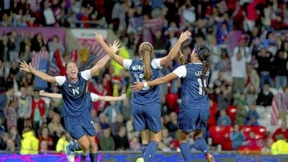 Soccer celebration Alex Morgan, center, celebrates with Abby Wambach, left, and Sydney Leroux after scoring the winning goal Monday.