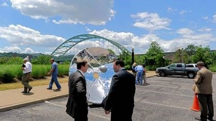 Solar Water Systems John Owsiany, left, the director of water systems and operations for Consol Energy speaks with Henry Wandrie, right, the COO of Epiphany Solar Water Systems, while they look over a solar dish used in a new water treatment system at shale fracking sites.