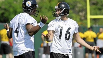 Spring Fling Byron Leftwich, left, and Charlie Batch talk something over during one of last week's OTAs.