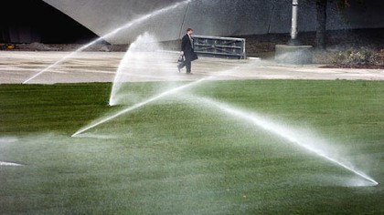 Sprinkler Use a sprinkler or an irrigation system to apply 1 inch of water weekly to your lawn when rain is minimal.