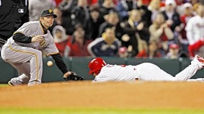 St. Louis' Yadier Molina St. Louis' Yadier Molina dives into third base with a triple in the second inning as the ball caroms away from Pirates third baseman Andy LaRoche.