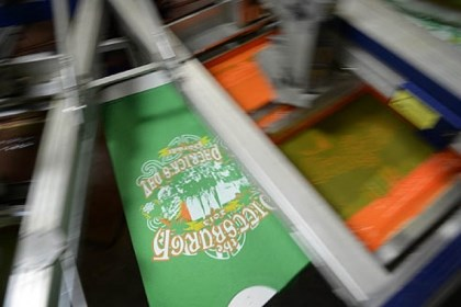 St. Patty's Day shirt_2 Pittsburgh's official St. Patrick's Day Parade T-shirt comes off the presses Thursday at All Pro Embroidery and Screenprinting in Baldwin.