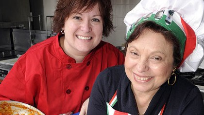 St. Thomas More's cooks Lucia Facco, right, with St. Thomas More hospitality manager Rebecca Zirpoli after preparing Linguine with Shrimp Sauce, one of eight of Mrs. Facco's pasta recipes on the menu for Lenten Friday meals at the church.