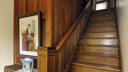 Staircase This staircase and paneling exemplify the Craftsman-style woodwork throughout the house.
