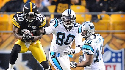 steeelers vs panthers Bryant McFadden makes one of two interceptions the Steelers had against Carolina's Matt Moore in the first half last night.