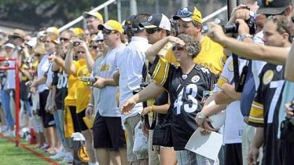 Steelers fans Steelers fans line up to watch their team during the first day of training camp in Latrobe Saturday.