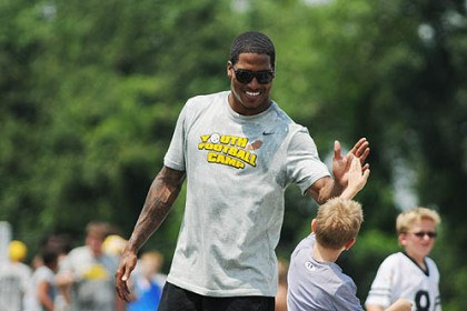 Steelers safety Steelers safety DaMon Cromartie-Smith high-fives 6-year-old Merrick Shumaker, of Monroeville, at a Football Youth Camp at West Allegheny High School in Imperial, Pa.