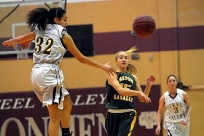 SteelValley Seton-LaSalle's Julie DeKlaven passes in front of Steel Valley's Cece Dixon.