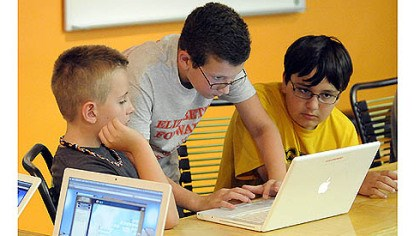 STEM program From left, Ethan Thoma, Carson Tokar and Broc Balta work on creating an online game.