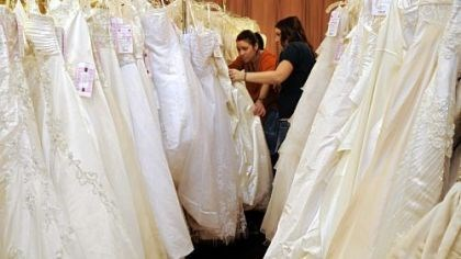 Stephanie Williams and Amanda Clyde browse Stephanie Williams, left, and her friend and bride-to-be Amanda Clyde, both of Ellwood City, go through the racks of dresses Sunday at the Center for Building Hope charity wedding gown sale at The Fez in Aliquippa.