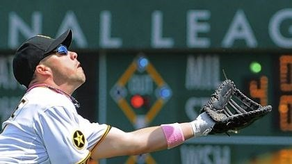 Steve Pearce Steve Pearce makes a diving attempt on a ball hit by the Houston Astros' Carlos Lee in the Pirates' 5-4 victory Sunday at PNC Park.