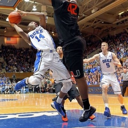 Sulaimon Duke's Rasheed Sulaimon does his best to get a shot off against Miami's Reggie Johnson in a top-five showdown between the Blue Devils and Hurricanes Saturday in Durham, N.C. No. 3 Duke held on for a 79-76 win.