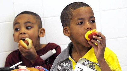 Good lunch Angel Butler, left, and Zyier Gibson, first-graders at Pittsburgh Sunnyside Elementary and Middle School in Stanton Heights have turkey hot dogs on whole wheat buns and locally grown peaches for lunch.