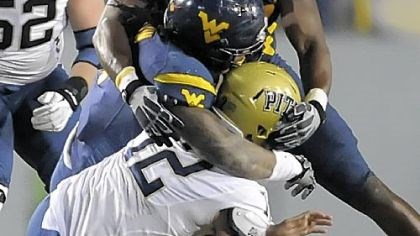 Sunseri West Virginia's Bruce Irvin and Will Clarke sack Pitt's Tino Sunseri in the fourth quarter Friday.