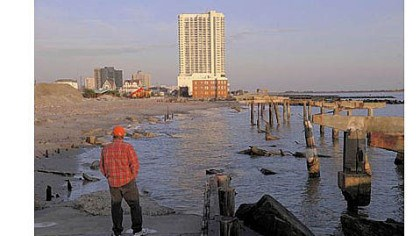 Superstorm Sandy Randy Rocha of Cherry Hill, N.J., surveys a section of boardwalk destroyed by Superstorm Sandy in northern Atlantic City. The boardwalk in front of the resort city?s casinos remains intact.