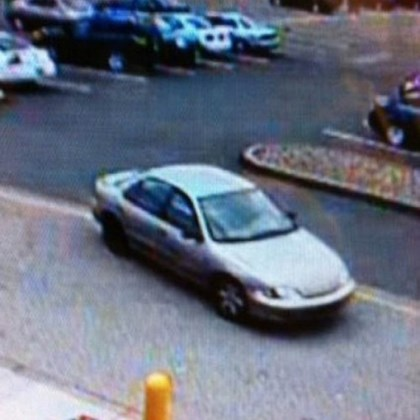 Suspect's sedan Surveillance footage of the four-door sedan the suspect is believed to have been driving.