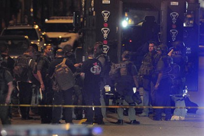 SWAT team and other emergency workers SWAT team and other emergency workers at the scene in the 4300 block of Main Street in Bloomfield.