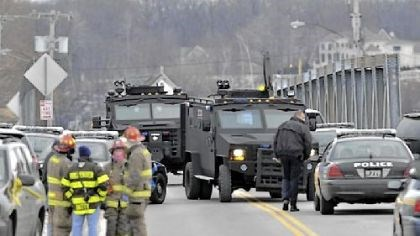 SWAT teams in Webster SWAT teams appear at the scene of a fire Monday in Webster, N.Y. Police say a man who killed two firefighters in a Christmas Eve ambush had served 17 years for manslaughter in the death of his grandmother.