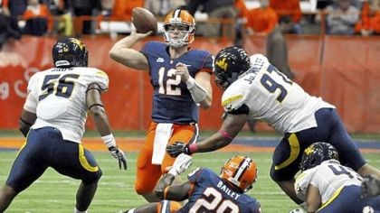 SyracuseWVU.jpg Syracuse quarterback Ryan Nassib (12) threw for 229 yards and four touchdowns as the Orange beat West Virginia, 49-23, last season.