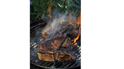 T-bone steaks T-bone steaks on the grill.