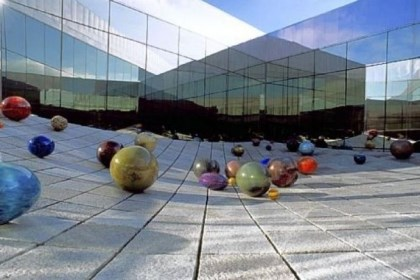"Tacoma Art Museum Richard Rhodes' untitled ""stone wave"" sculpture at Tacoma Art Museum is decorated with Ma Chihuly's Floats (in honor od Dale Chihuly's mother) during the summer months."