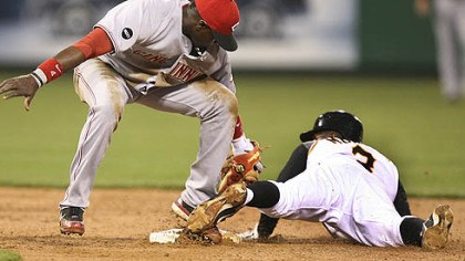 Tagged Cincinnati Reds' second baseman Brandon Phillips, left, makes the tag on Nyjer Morgan as Morgan is caught stealing second base in the third inning of their game last at PNC Park.
