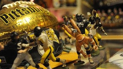 Take that, Browns fan More hand-painted miniatures. No. 92 is body-slamming a Browns fan. Several years ago, linebacker James Harris (who wears 92) did just that to a drunken Browns fan who ran onto the field.