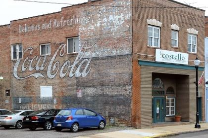 "Tarentum business district Tarentum has used grant money to restore some of its ""ghost signs,"" painted signs that have faded, such as this Coca-Cola advertisement in the 200 block of East Fifth Avenue."