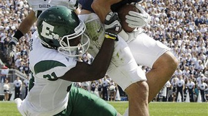 TD Penn State receiver Derrick Moye hauls in a Matt McGloin pass for a touchdown as Eastern Michigan's Marcell Rose drops him in the endzone during the second quarter of today's game in State College.