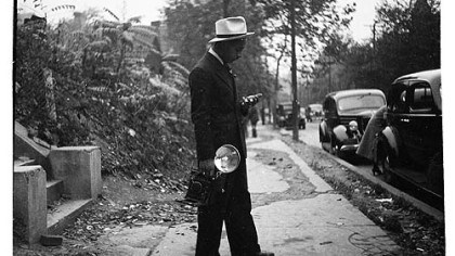 Teenie Harris c, 1938 Teenie Harris, holding camera and standing on sidewalk, c. 1938.