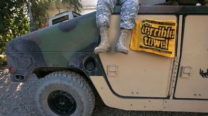 Terrible Towel in Iraq A member of the Pennsylvania National Guard sits on a Humvee draped with a Terrible Towel in January 2005 in Camp Habbaniyah, Iraq.
