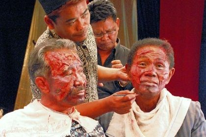 "'The Act of Killing' The documentary ""The Act of Killing"" re-enacts horrific crimes, complete with makeup and costumes."