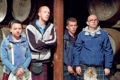 "'The Angels Share' Jasmin Riggins, left, William Ruane, Paul Brannigan and Gary Maitland attend a pricey whisky auction in ""The Angels' Share."""