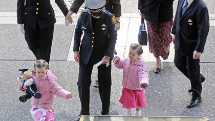 The family of slain Officer Stephen J. Mayhle The family of slain Officer Stephen J. Mayhle ? widow Shandra, rear second from left, and daughters Jennifer, 6, and Brooklynn, 3 ? arrives for the final viewing at the City-County Building yesterday.