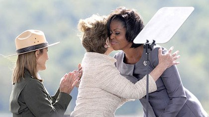 The first ladies First Lady Michelle Obama and former First Lady Laura Bush embrace during the Flight 93 National Memorial ceremony in Shanksville today.