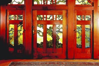 The front door of the Gamble House The front door of the Gamble House is a masterpiece in teak and forest-toned art glass.