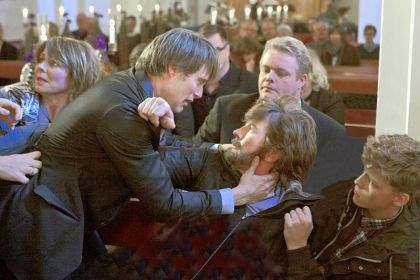"'The Hunt' During a church service, Mads Mikkelsen, left, confronts Thomas Bo Larsen, who plays his best friend in ""The Hunt."""