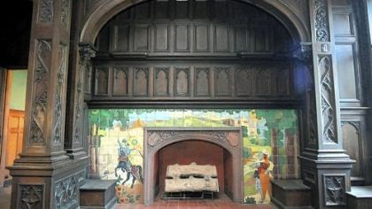 The McCook Mansion The grand hall's huge fireplace features a scene with a castle and two knights, one of whom is on a rearing black horse. The mansion has 11 fireplaces.