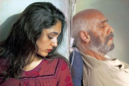 "'The Patience Stone' As her husband, portrayed by Hamidreza Javdan, lies in a coma, Golshifteh Farahani takes the opportunity to unburden herself in ""The Patience Stone."""