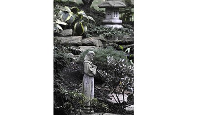 The Polena garden A statue of Saint Francis graces the backyard are of the Polena's garden.