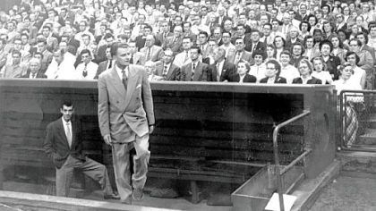 The Rev. Billy Graham The Rev. Billy Graham emerges from the Pirates' dugout at Forbes Field to deliver a sermon in his first visit in September 1952.