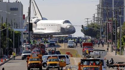 The Space Shuttle Endeavour The Space Shuttle Endeavour slowly moves along city streets Friday in Los Angeles on a 160-wheeled carrier.