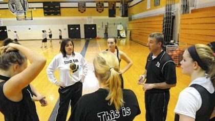 The Wilsons Husband-and-wife basketball coaches Debby and Dave Wilson run the South Side Beaver girls practice Dec. 31. The Wilsons are believed to be the first husband and wife coaching duo in WPIAL history.