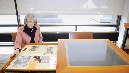 Thornburgh Collection at Hillman Library Nancy Watson, curator of the Thornburgh Collection at Hillman Library, opens a drawer in a display table with material from the Three Mile Island accident in the Dick Thornburgh room at the University of Pittsburgh library.