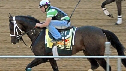 titletown five Exercise rider Rudy Quevedo trots Preakness Stakes entrant Titletown Five the wrong way on the track Thursday at Pimlico Race Course in Baltimore.