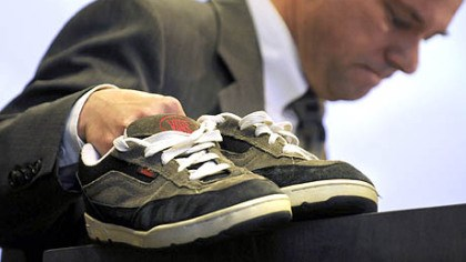 Tom Mauser While addressing the National Symposium on Handgun Violence at Duquesne University, Tom Mauser displays the shoes of his son, Daniel, who was killed at Columbine High School. Mr. Hauser wears the shoes on special occasions.