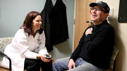 Toni Pais and Valerie Suski Toni Pais talks to UPMC neurologist Valerie Suski during a February checkup.