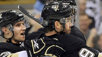 Top line topper Pascal Dupuis is congratulated by teammate Alex Goligoski after his goal Saturday night. He has been adjusting well to the Penguins' top line.