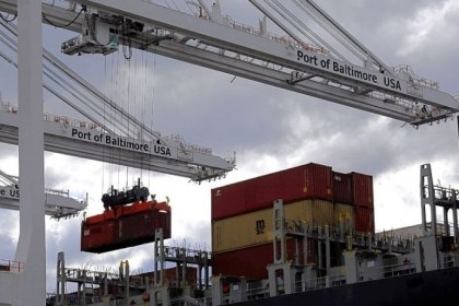 trade deficit narrows A crane removes a container from a ship at the Port of Baltimore's Seagirt Marine Terminal. The U.S. trade deficit unexpectedly narrowed in February as exports climbed close to an all-time high.
